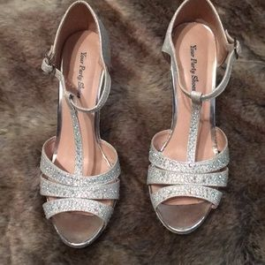 Very nice silver dress wedge heeled shoes.